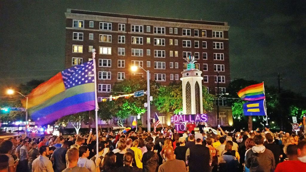 North Texas' LGBT community rallies in front of the Legacy of Love Monument in Oak Lawn, Dallas, on June 13, 2016. The rally was held to protest a mass shooting at Pulse Night Club in Orlando, Fla., the previous day.