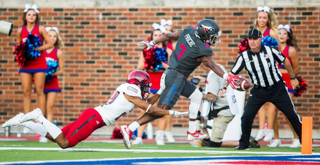 Southern Methodist Mustangs wide receiver James Proche (3) crosses the goal line with the ball for a touchdown while being tackled by Arkansas State Red Wolves defensive back Jeremy Smith (24) during the first quarter of a game between Arkansas State and SMU on Saturday, September 23, 2017 at Ford Stadium on the SMU campus in Dallas. (Ashley Landis/The Dallas Morning News)