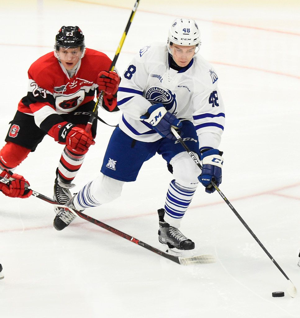 MISSISSAUGA, ON - OCTOBER 21: Thomas Harley #48 of the Mississauga Steelheads battles for the puck against Marco Rossi #23 \and Tye Felhaber #29 of the Ottawa 67s during OHL game action on October 21, 2018 at Paramount Fine Foods Centre in Mississauga, Ontario, Canada. (Photo by Graig Abel/Getty Images) ORG XMIT: 775228338