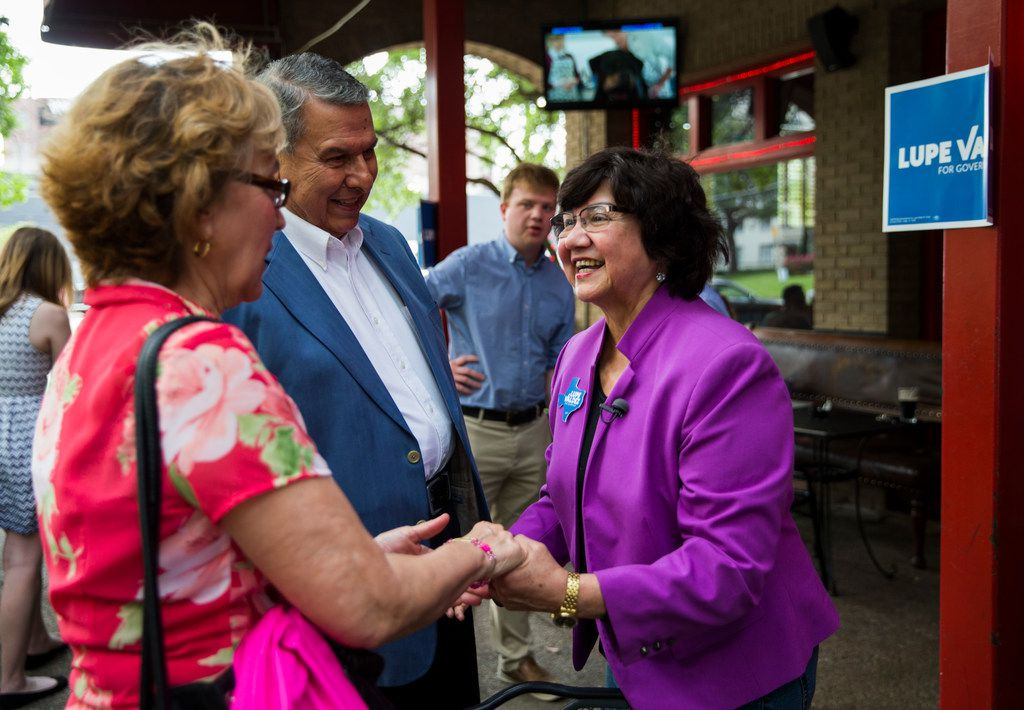 Gubernatorial candidate and former Dallas sheriff Lupe Valdez greets supporters Carmen and Juan Castaneda at a campaign event on Wednesday, May 2, 2018 at Stoneleigh P in Dallas.