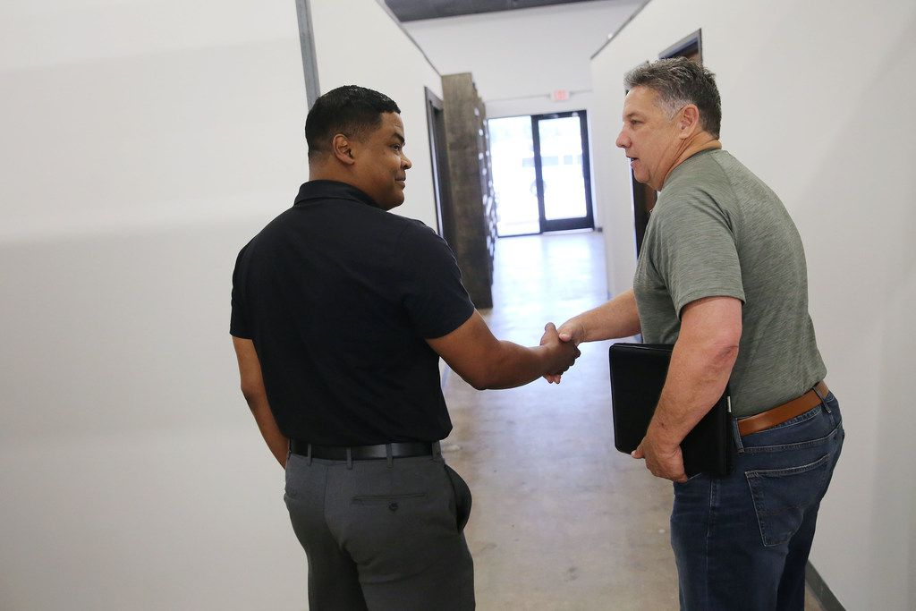 Yodchai Roseborough (left), an insurance specialist with Insurament, shakes hands with Monte Anderson while Roseborough looks for rental space inside DeSoto Market Place in DeSoto. DeSoto Market Place is a retail incubator by Anderson, who is the developer and owner of the property. Anderson wanted authentic and locally made retail to fill the space. Rental spaces are available monthly from $350 to $1,400