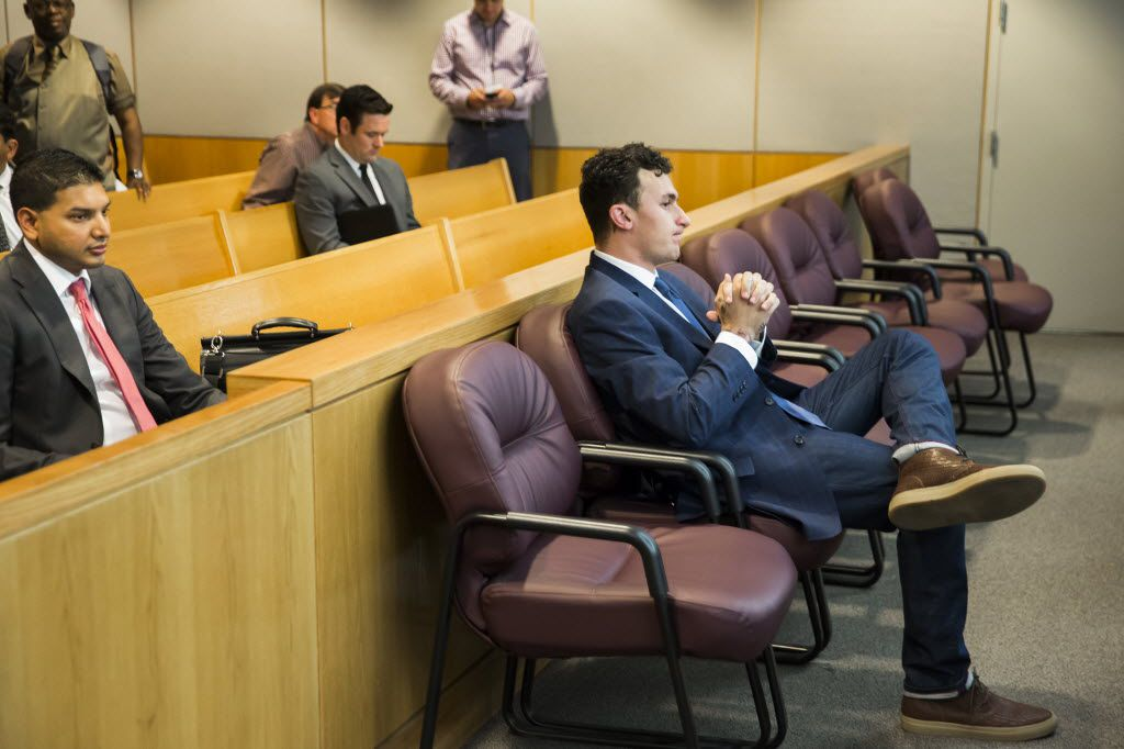 Former Texas A&M and Cleveland Browns quarterback Johnny Manziel sits at the back of the courtroom while his defense attorneys confer with the prosecution after he appeared before Judge Roberto Cañas at the Frank Crowley Courts Building on Thursday, May 5, 2016, in Dallas. Manziel reported to court Thursday for the first time since a Dallas County grand jury indicted him last month on a misdemeanor domestic violence charge. Former girlfriend Colleen Crowley has accused him of kidnapping, hitting and threatening to kill her in January. Smiley N. Pool/The Dallas Morning News)