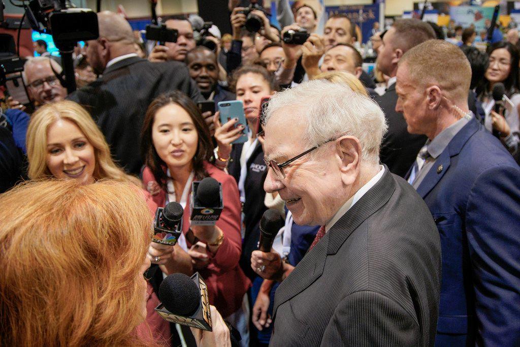 Warren Buffett speaks to reporters before presiding over the annual shareholders meeting.