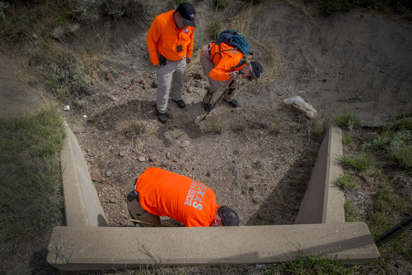 Members of Texas Search and Rescue check out a culvert Saturday, Oct. 22, 2016 during their search for Zuzu Verk.