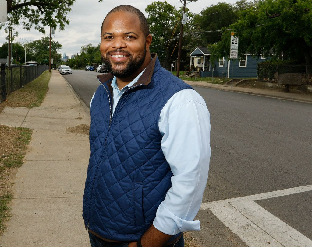 Dallas Rep. Eric Johnson poses on Bickers Street in West Dallas, on Wednesday, April 25, 2018. He grew up in West Dallas and is now trying to have a plaque removed from the State Capital that says slavery wasn't an underlying cause of the Civil War.