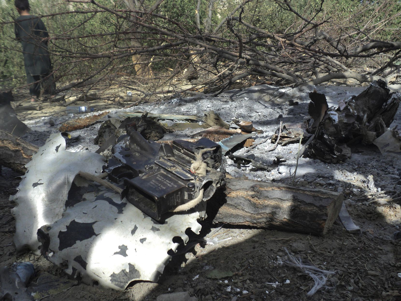 Wreckage of the Chinook helicopter at the site of the crash killing 30 Americans and eight Afghans. The helicopter that insurgents shot down burst into flames before hitting the ground, leaving wreckage scattered on both sides of a river, witnesses told The Associated Press.