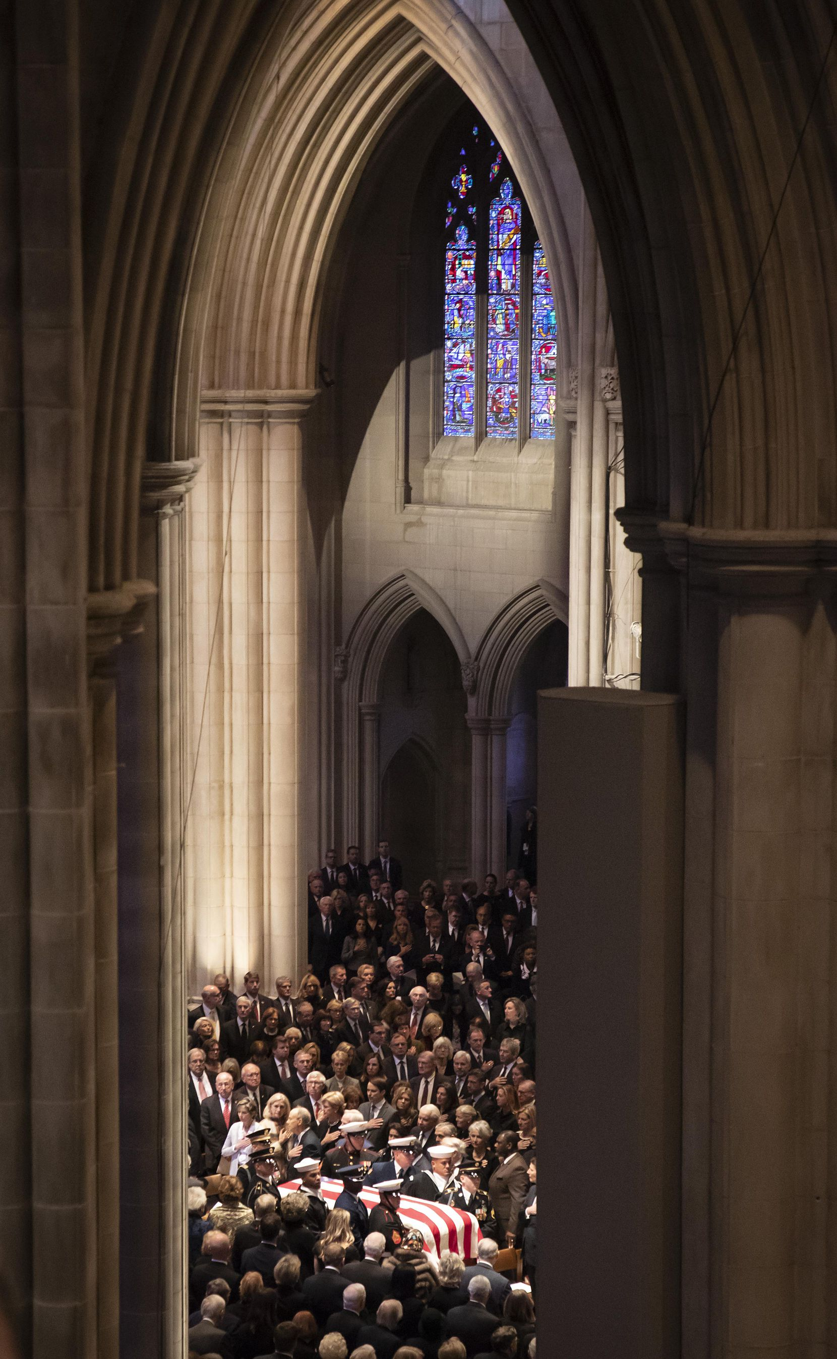 A military honor guard carries the flag-draped casket into the Washington National Cathedral at the beginning of the State Funeral for George H.W. Bush, the 41st President of the United States, on Wednesday, Dec. 5, 2018, in Washington. (Smiley N. Pool/The Dallas Morning News)