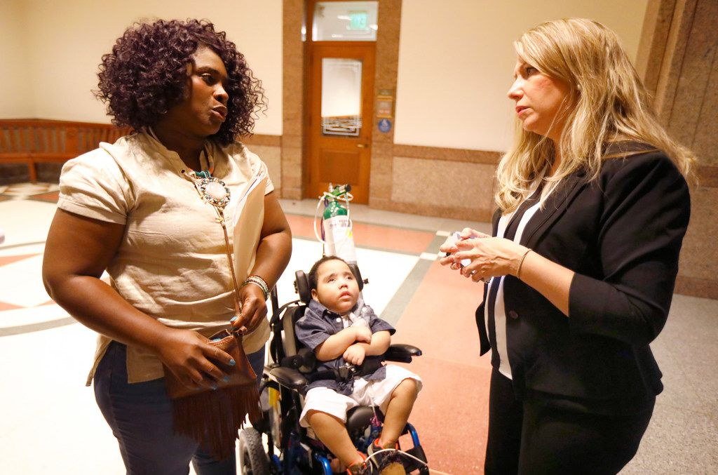 Linda Badawo of Mesquite, Texas and her 3 yr-old son D'ashon Morris (left) visit with Flower Mound mother Hannah Mehta of TX Fragile Kids following her testimony at the Texas House Committee on Human Services meeting.  Badawo testified before the panel.