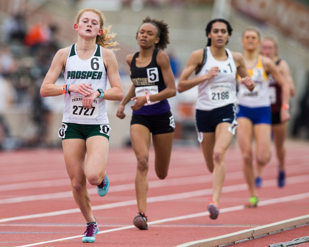 Prosper's Aubrey O'Connell (left) crosses the finish line first in the High School Girls 1600 Meter race during the Texas Relays track and field meet on Friday, March 29, 2019 at Mike A. Meyers Stadium at the University of Texas in Austin. (Ashley Landis/The Dallas Morning News)