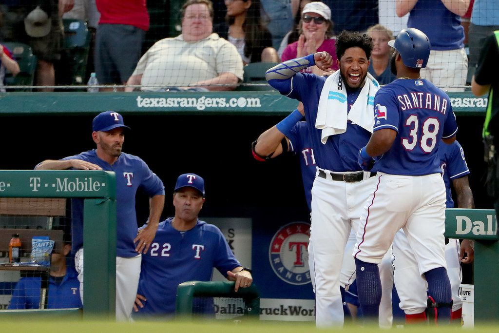 ARLINGTON, TEXAS - JUNE 17: Danny Santana #38 of the Texas Rangers celebrates with Elvis Andrus #1 of the Texas Rangers after hitting a two-run home run against the Cleveland Indians in the bottom of the fourth inning at Globe Life Park in Arlington on June 17, 2019 in Arlington, Texas. (Photo by Tom Pennington/Getty Images)