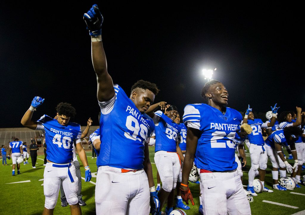 Duncanville defensive lineman Quincy Wright (99) lifts his fist as his team celebrates a 61-0 win over Skyline on Friday, October 4, 2019 at Panther Stadium in Duncanville. (Ashley Landis/The Dallas Morning News)