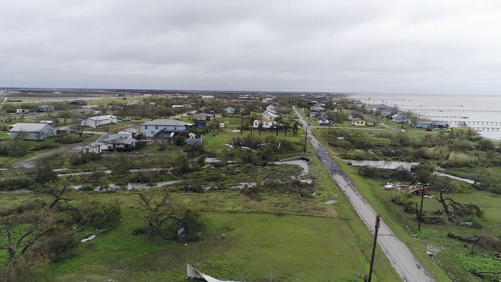 This aerial image shows damage from Hurricane Harvey on Monday, Aug. 28, 2017, in Bayside, Texas. Harvey hit the coast as a Category 4 hurricane. (DroneBase via AP)