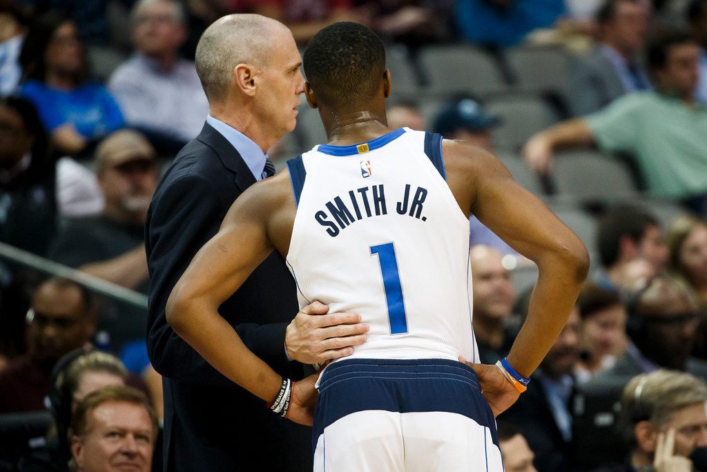 FILE - Mavericks guard Dennis Smith Jr. (1) confers with coach Rick Carlisle during a preseason game against the Chicago Bulls at American Airlines Center on Wednesday, Oct. 4, 2017, in Dallas. (Smiley N. Pool/The Dallas Morning News)