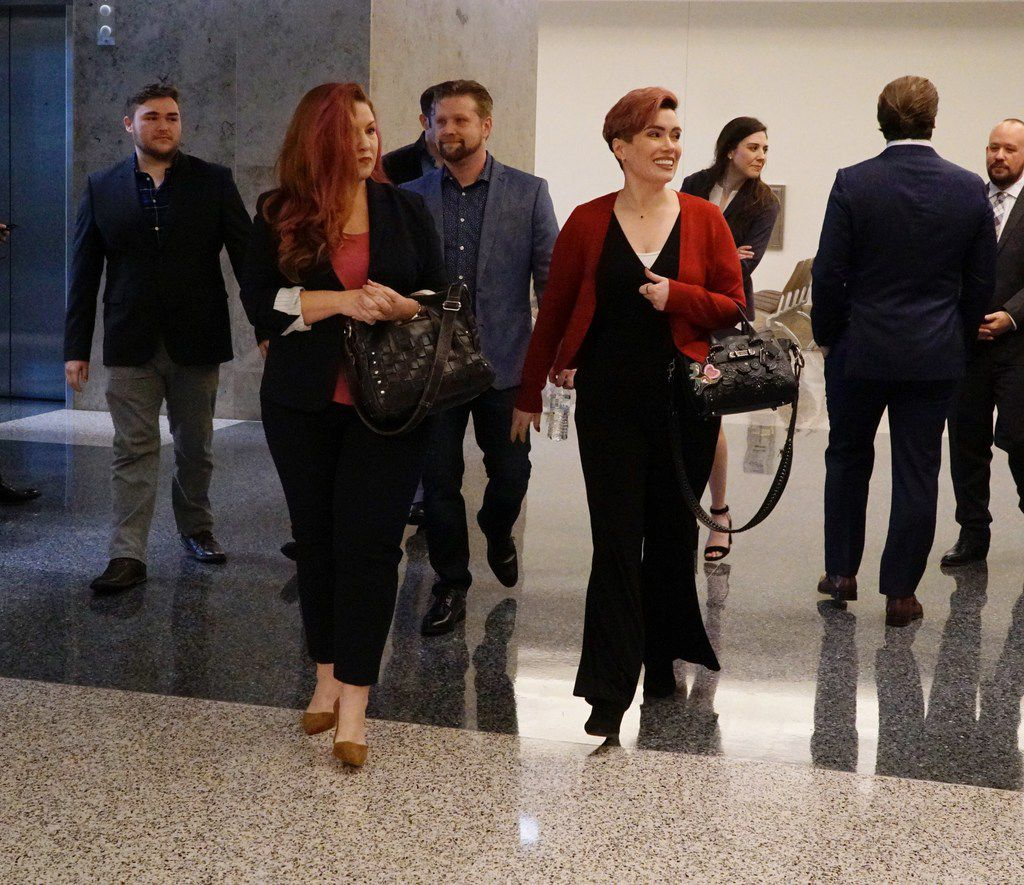 Jamie Marchi, left, and Monica Rial outside the Tarrant County courtroom Sept. 6 where Judge John Chupp made the first of his rulings in their defamation case brought against them.
