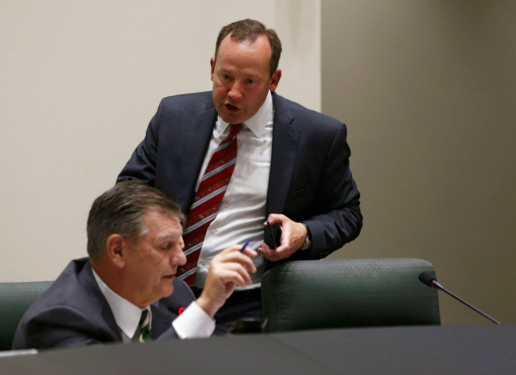 Dallas City council member Philip T. Kingston rushes over to talk to Dallas mayor Mike Rawlings after ripping up a copy of an amendment proposed by Dallas City council member B. Adam McGough after Rawlings told him during a meeting at Dallas City Hall in Dallas on Wednesday, April 24, 2019. The city council voted Wednesday to mandate Dallas businesses within the city limits to provide earned paid sick time to employees. (Vernon Bryant/The Dallas Morning News)