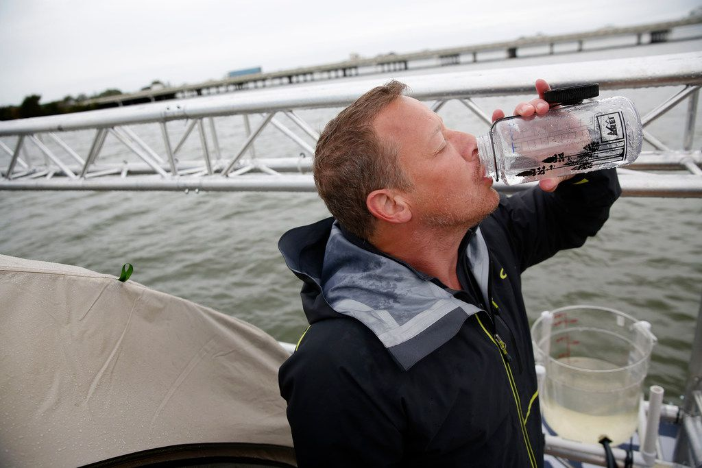 Todd Phillips, founder and director of the Last Well, drinks filtered water on his wooden barge on Lake Ray Hubbard in Rockwall.