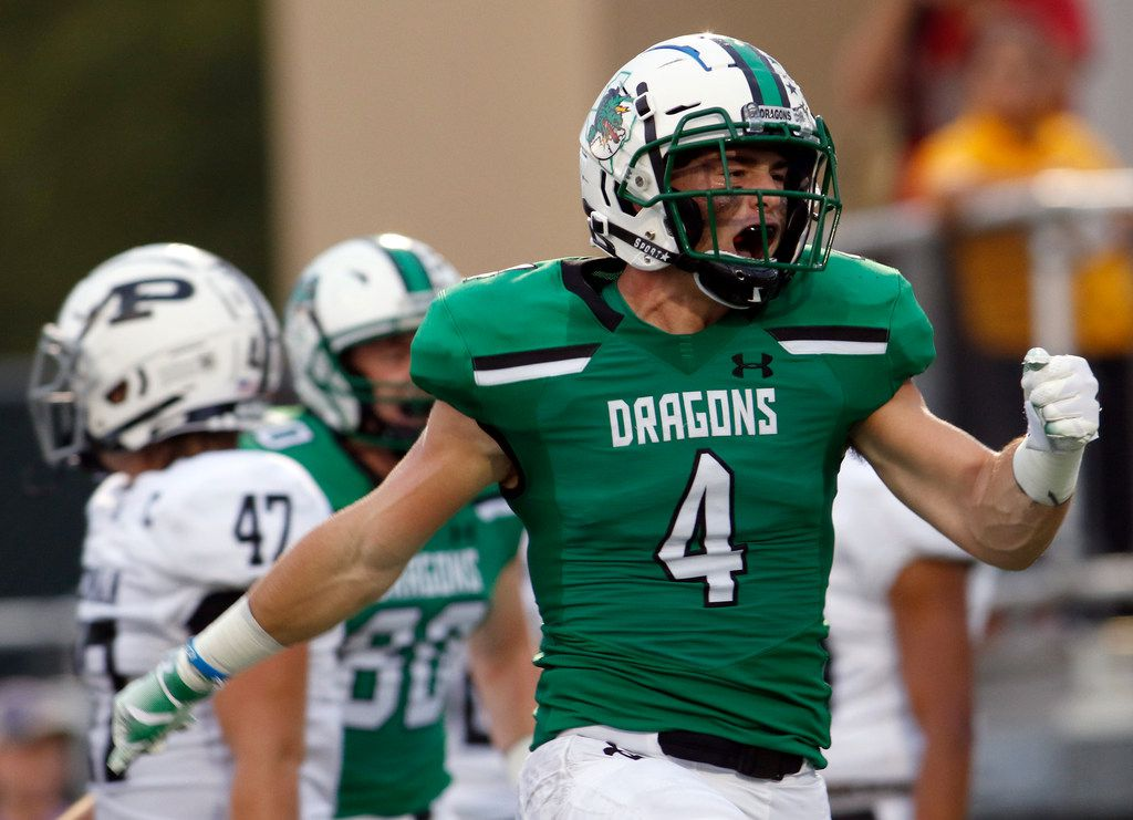 FILE - Southlake Carroll running back T.J. McDaniel (4) lets out a yell after igniting a capacity home crowd following his 56-yard rushing touchdown to break a scoreless tie in the first quarter of their game against Odessa Permian.The two teams played their non-district  football game at Southlake Carroll's Dragon Stadium in Southlake on September 14, 2018.  (Steve Hamm/ Special Contributor)
