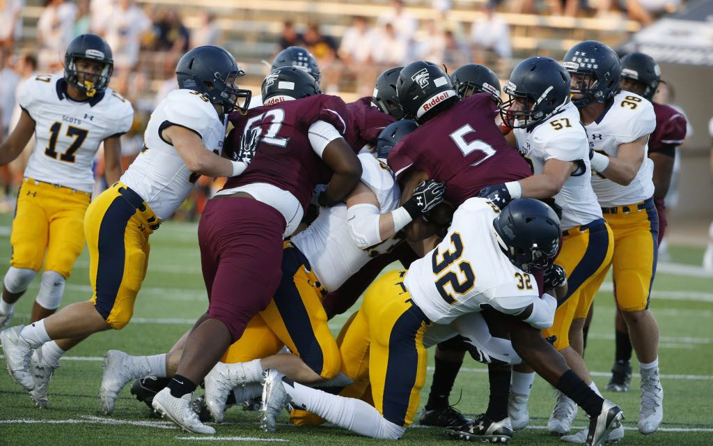 Highland Park defenders tackle Mansfield Timberview quarterback Jyron Russell (#5) during the first half of their high school football game in Mansfield, Texas on September 14, 2017. (Michael Ainsworth)