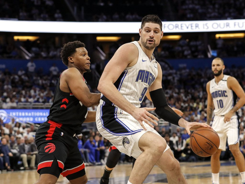 ORLANDO, FL - APRIL 19: Nikola Vucevic #9 of the Orlando Magic backs Kyle Lowry #7 of the Toronto Raptors in the post during Game Three of the first round of the 2019 NBA Eastern Conference Playoffs at the Amway Center on April 19, 2019 in Orlando, Florida. The Raptors defeated the Magic 98 to 93. NOTE TO USER: User expressly acknowledges and agrees that, by downloading and or using this photograph, User is consenting to the terms and conditions of the Getty Images License Agreement. (Photo by Don Juan Moore/Getty Images)