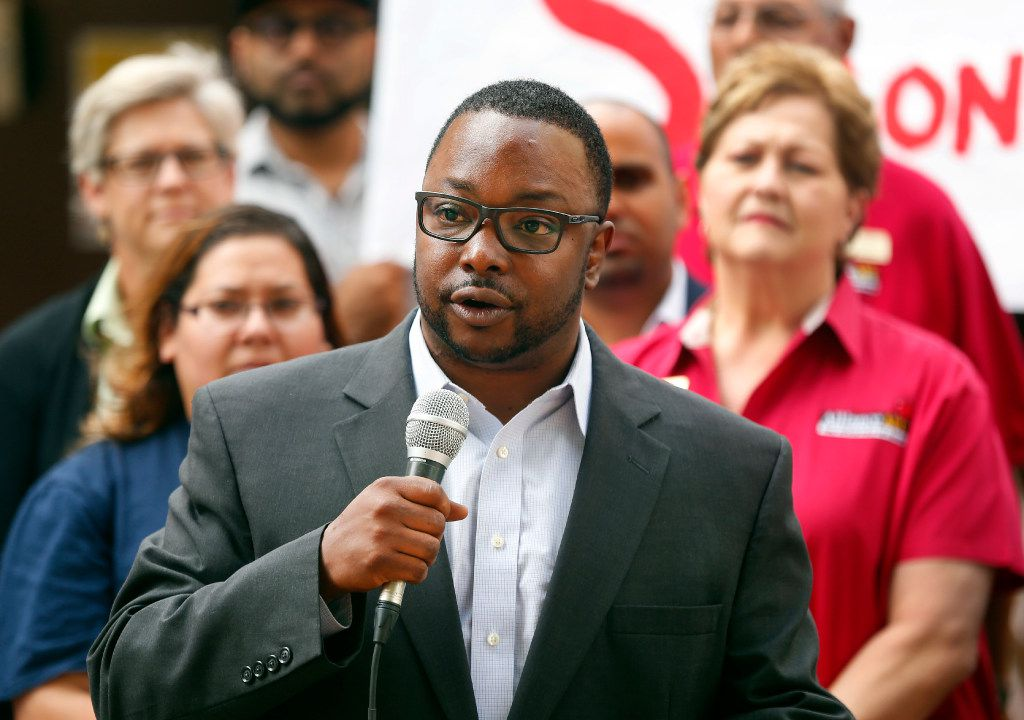 Our Community, Our Schools representative Edward Turner speaks to those gathered for a press conference announcing the launch of Strong Schools Strong Dallas coalition, a diverse group of North Texas organizations supporting a Tax Ratification Election (TRE).  The advocacy group seeks adequate funding to advance educational outcomes for Dallas Independent School District (DISD). The press conference was held at the Holland Elementary School in Dallas, Thursday, April 20, 2017. (Tom Fox/The Dallas Morning News)