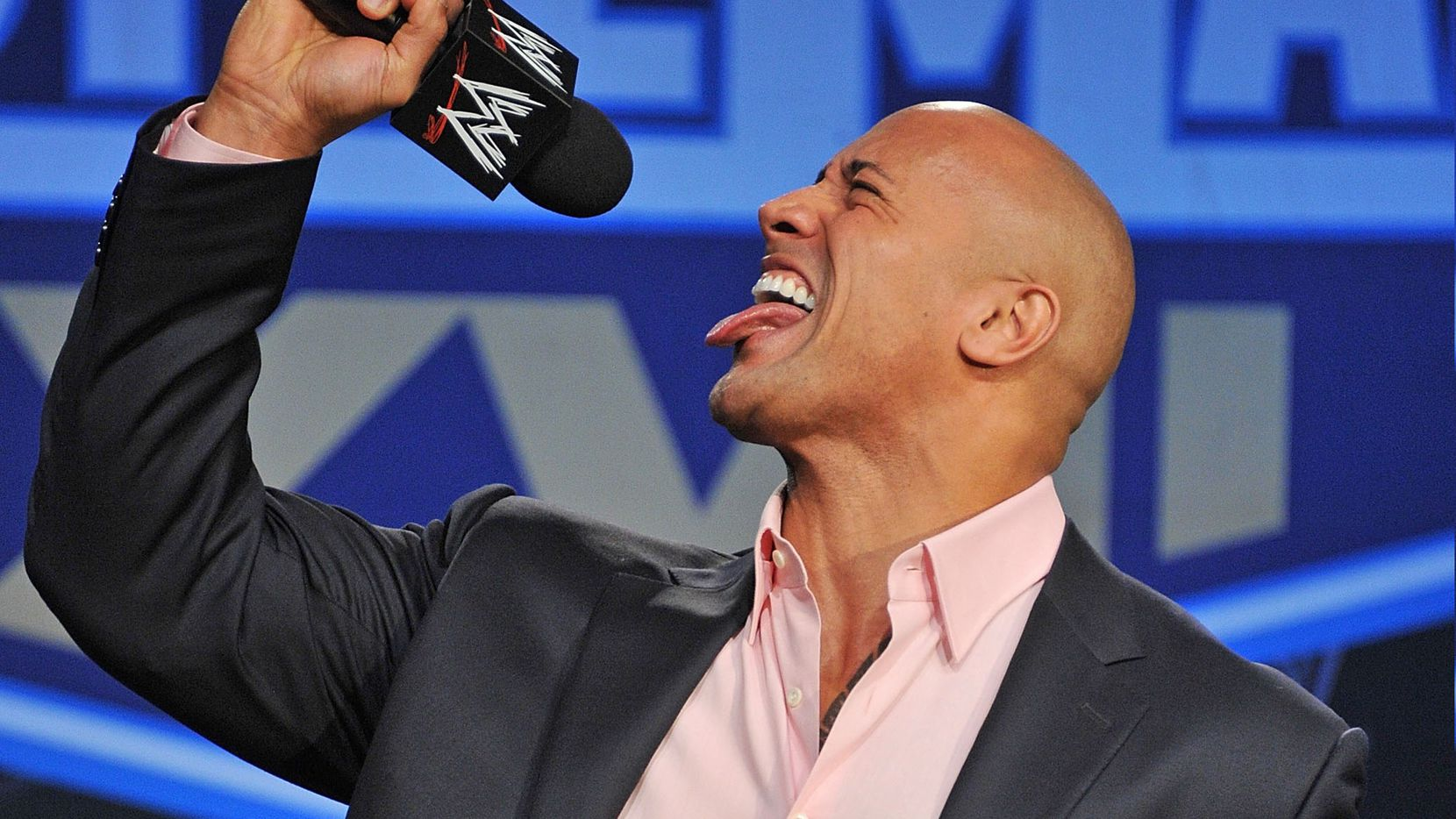 """Dwayne """"The Rock"""" Johnson attends the WrestleMania XXVII press conference at Hard Rock Cafe New York on March 30, 2011 in New York City."""