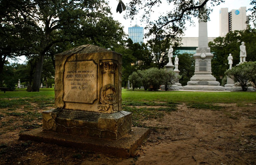The John Neely Bryan memorial stands before the Confederate War Memorial in Pioneer Park cemetery in downtown Dallas.