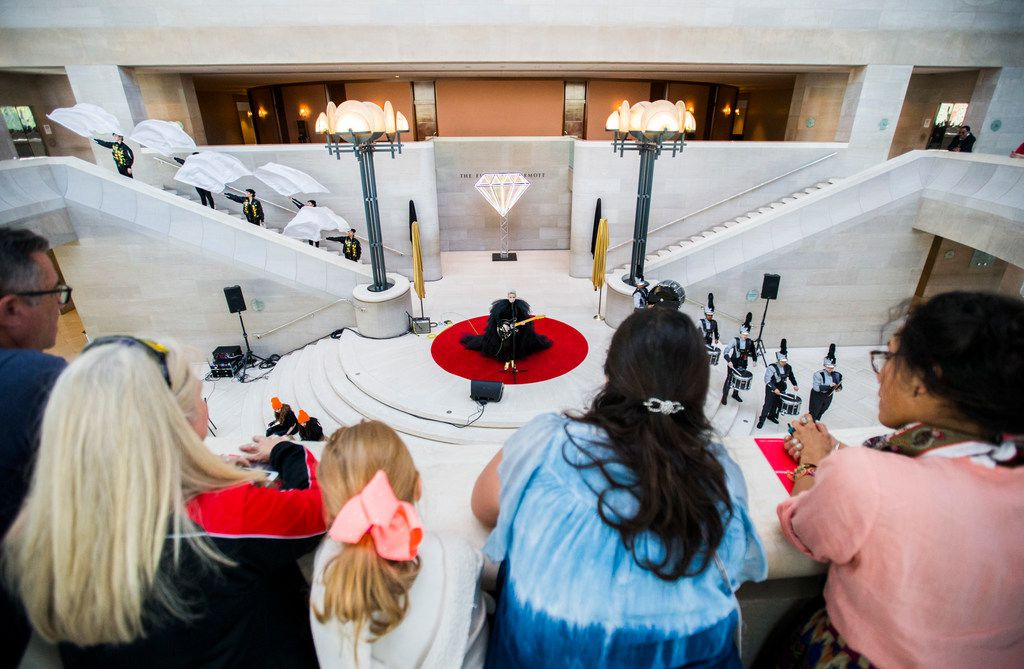 """People watch from the balcony as musician Sarah Jaffe performs during a pop-up performance entitled """"Eyes as Bright as Diamonds"""" to kick off the Soluna International Music & Arts Festival on Wednesday, April 11, 2018 at the Morton H. Meyerson Symphony Center in Dallas. The performance brings together New York artist Jen Ray, musician Sarah Jaffe and several Dallas performers. (Ashley Landis/The Dallas Morning News)"""