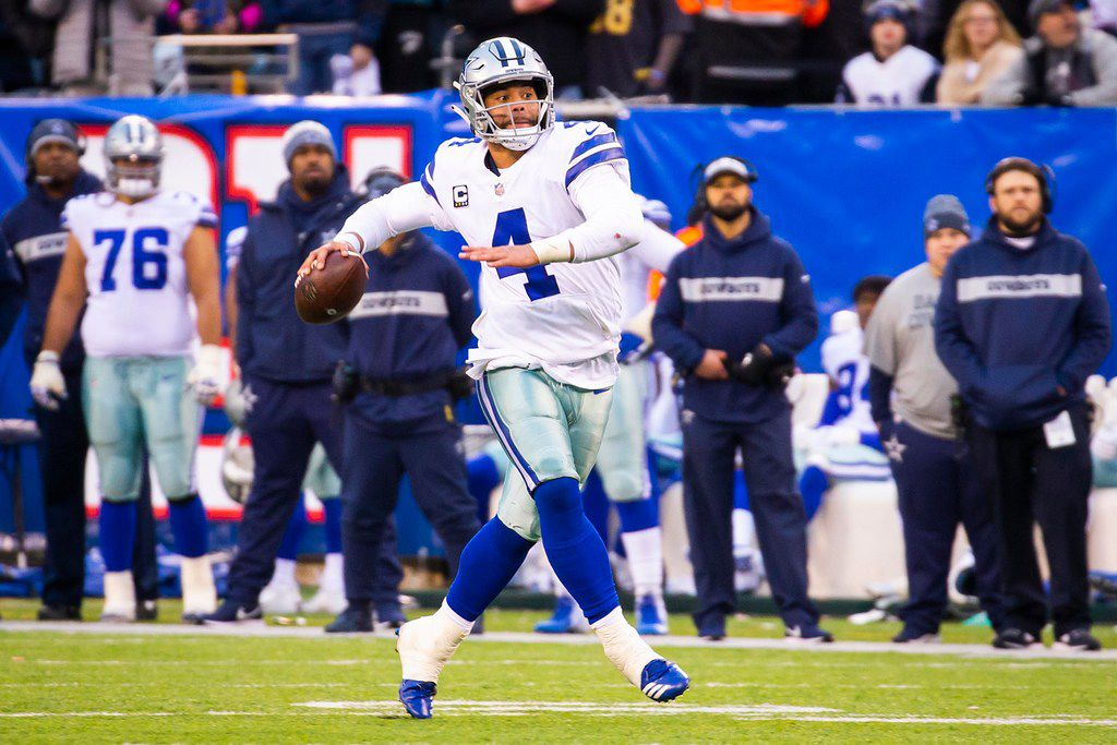 Dallas Cowboys quarterback Dak Prescott (4) scrambles away and throws a 32-yard touchdown  pass to wide receiver Cole Beasley on a 4th and 15 play during the fourth quarter of an NFL football game at against the New York Giants MetLife Stadium on Sunday, Dec. 30, 2018, in East Rutherford, New Jersey. The Cowboys won the game 36-35. (Smiley N. Pool/The Dallas Morning News)