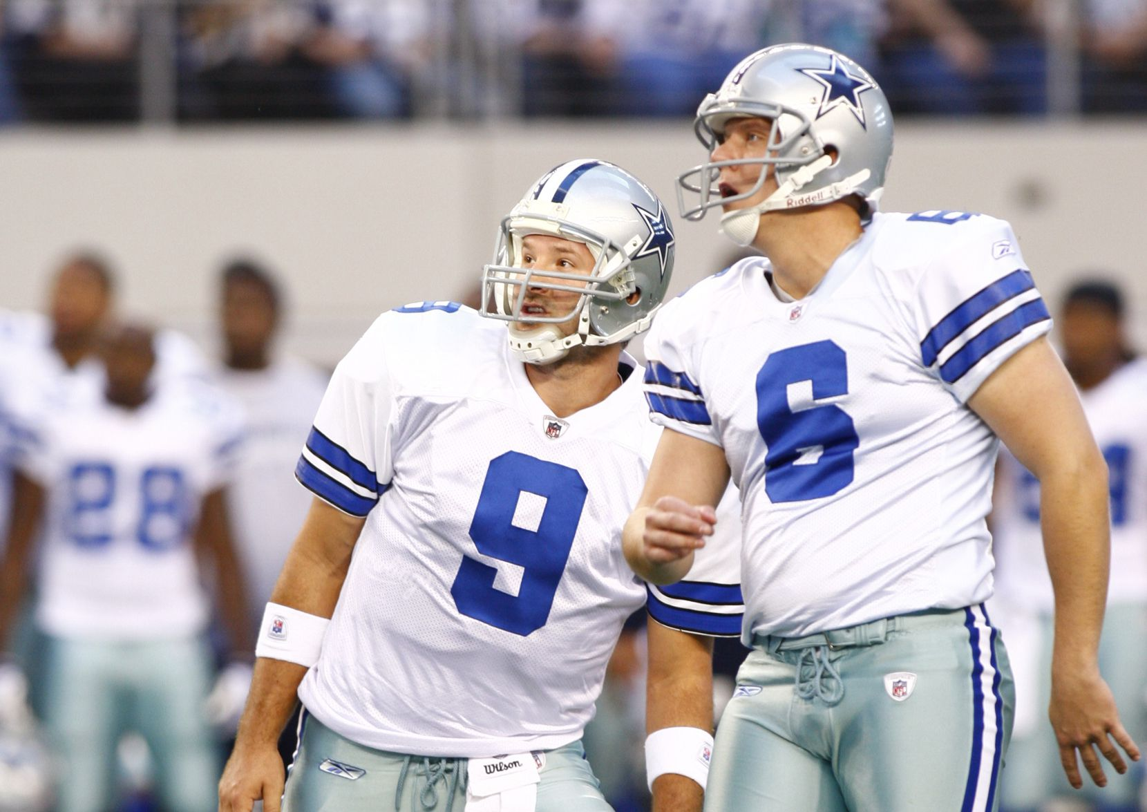 Nick Folk (6) and Dallas Cowboys quarterback Tony Romo (9) watch Folk's first quarter kick for a field goal sail towards the goalposts during first half NFL football action between the Dallas Cowboys and the San Diego Chargers at Dallas Cowboys Stadium in Arlington on Sunday, December 13, 2009. (John F. Rhodes / The Dallas Morning News)