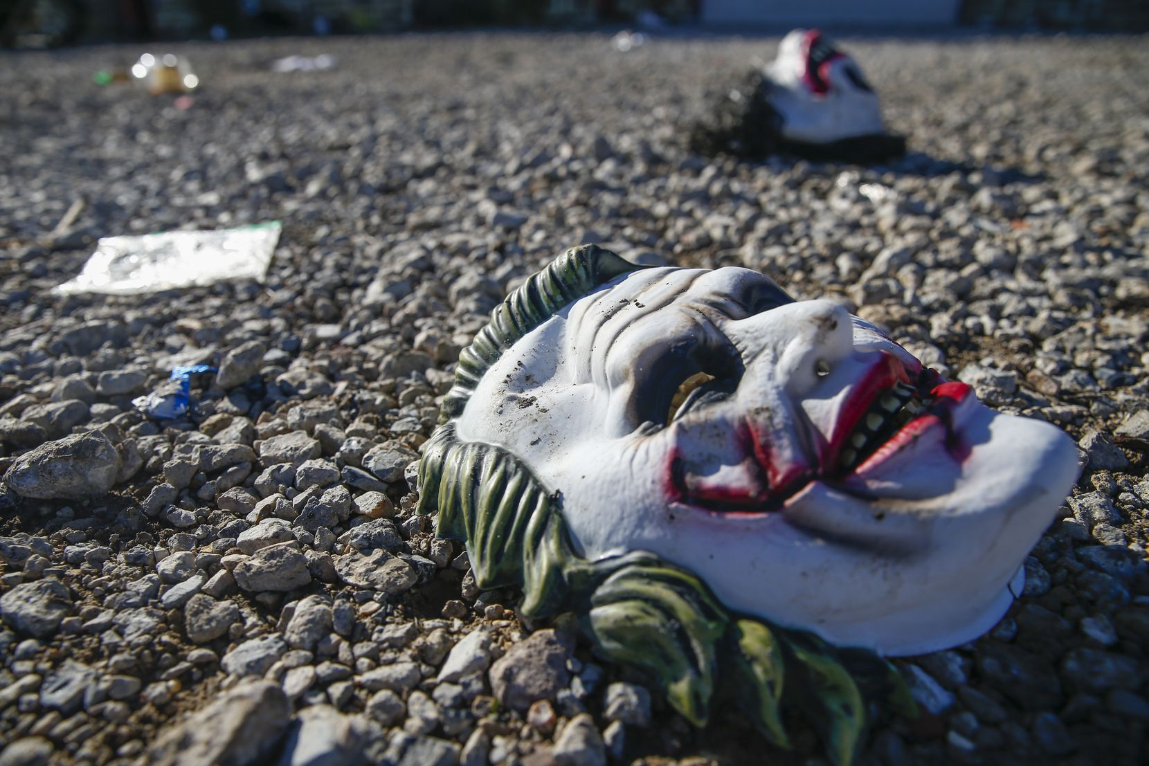 Halloween masks litter the ground among signs of chaos at the scene where a mass shooting occurred the night before at The Party Venue.