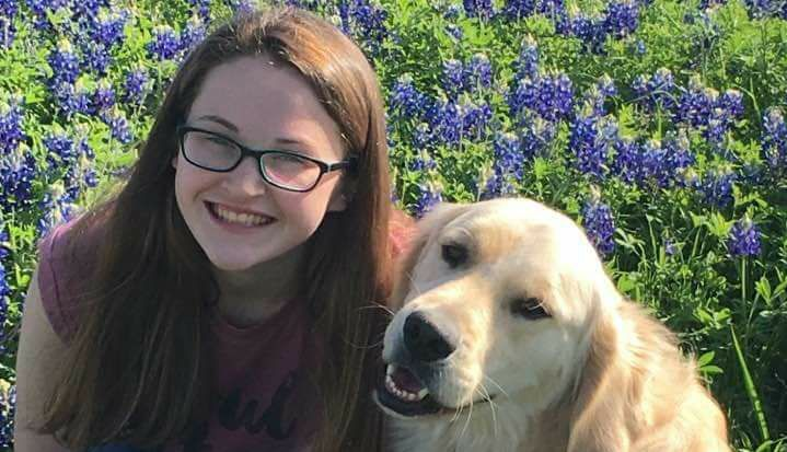 Hannah Westmoreland with her service dog, Journey.