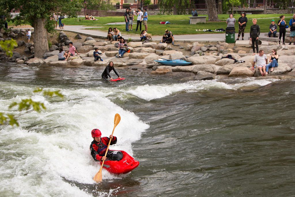 Former junior world champion freestyle kayaker and Reno native Jason Craig surfs the Truckee River Whitewater Park in Reno.