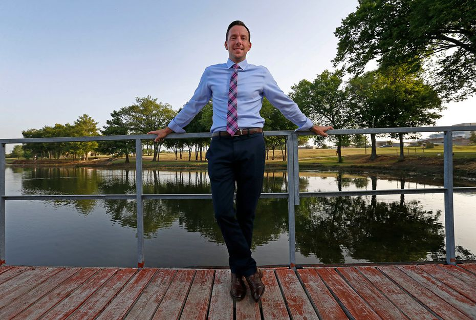 Michael Kowski , standing at Towne Lake Recreation Area, is director of parks and recreation in McKinney