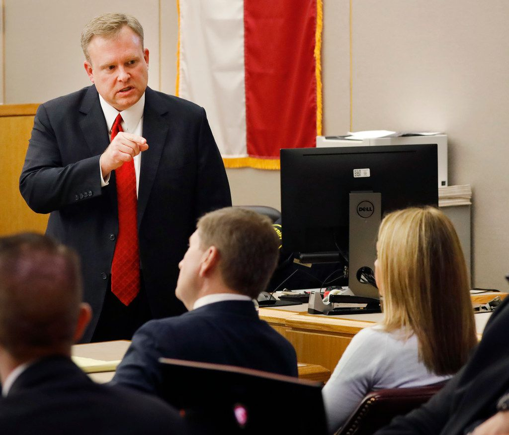 Assistant District Attorney Jason Hermus (left) finishes his closing arguments by pointing at the defendant, Amber Guyger (right) in her murder trial in the 204th District Court on Monday, September 30, 2019. The jury has now taken the case for decision.