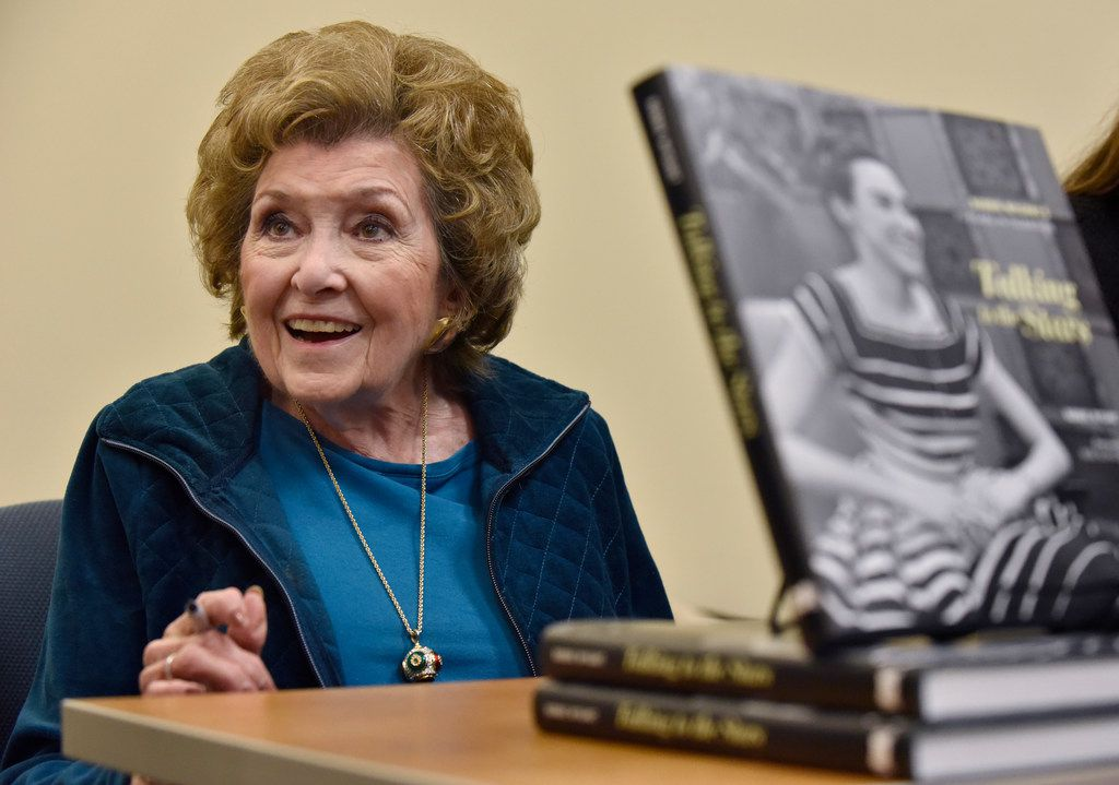 "Bobbie Wygant, 92, meets with fans during a book signing of her book ""Talking to the Stars"" after speaking at the Oak Cliff Lions Club's weekly luncheon on Dec. 18 in Dallas."