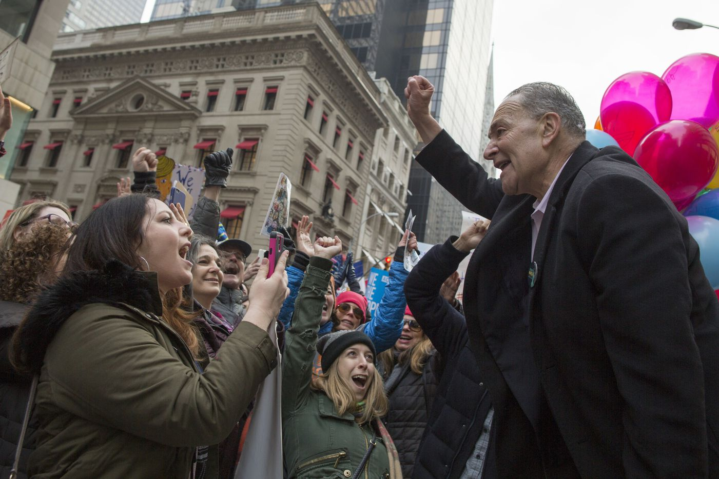 Senate Minority Leader Charles Schumer of N.Y, joins demonstrators marching up 5th Avenue during a women's march, Saturday, Jan. 21, 2017, in New York. The march is being held in solidarity with similar events taking place in Washington and around the nation.