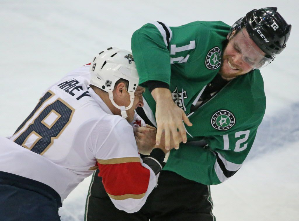 Dallas Stars center Radek Faksa (12) and Florida Panthers center Micheal Haley (18) fight during the first period during the Florida Panthers vs. the Dallas Stars NHL hockey game at the American Airlines Center in Dallas on Tuesday, January 23, 2018. (Louis DeLuca/The Dallas Morning News)