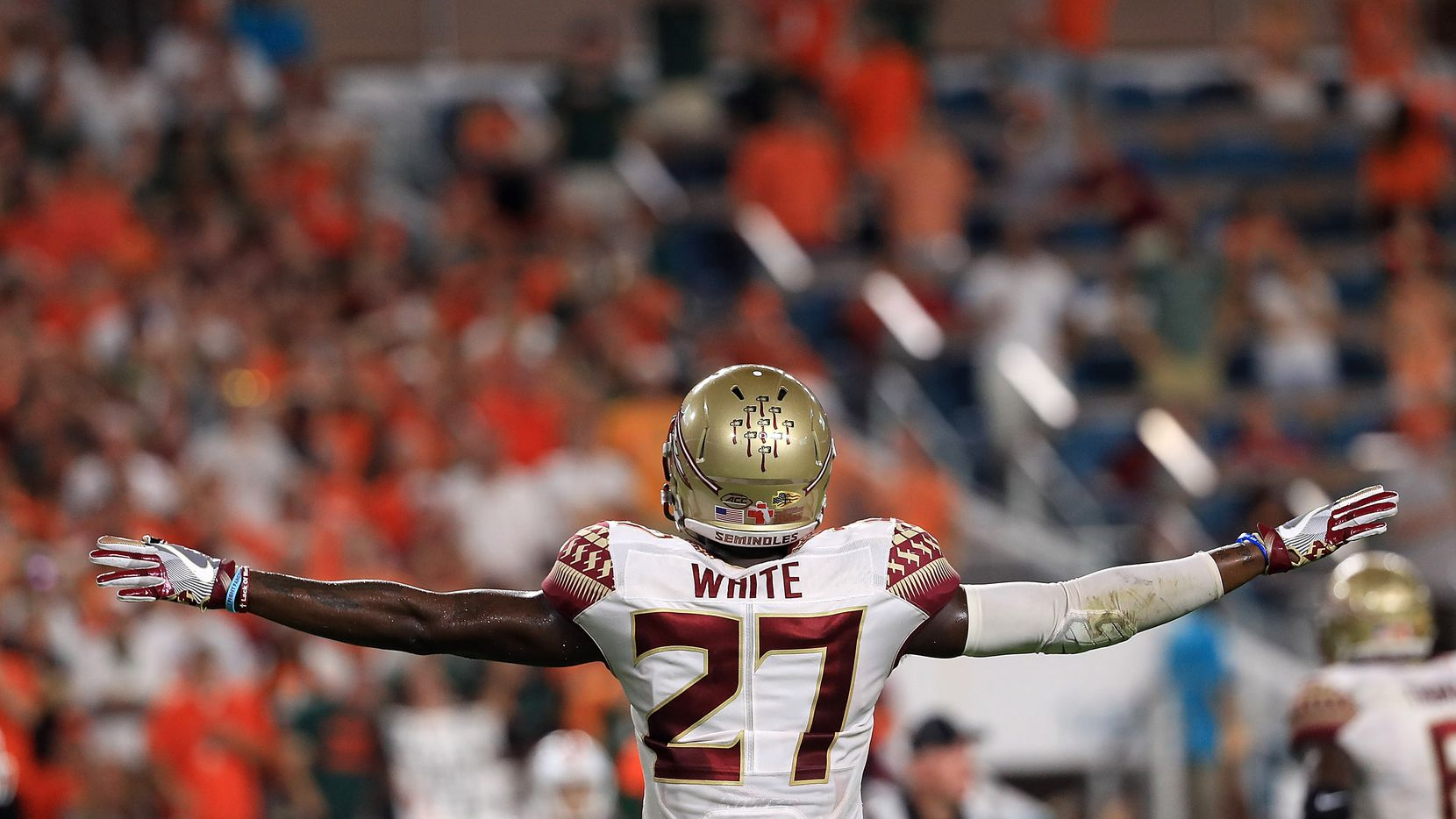 MIAMI GARDENS, FL - OCTOBER 08: Marquez White #27 of the Florida State Seminoles reacts to a play during a game  against the Miami Hurricanes at Hard Rock Stadium on October 8, 2016 in Miami Gardens, Florida.  (Photo by Mike Ehrmann/Getty Images)