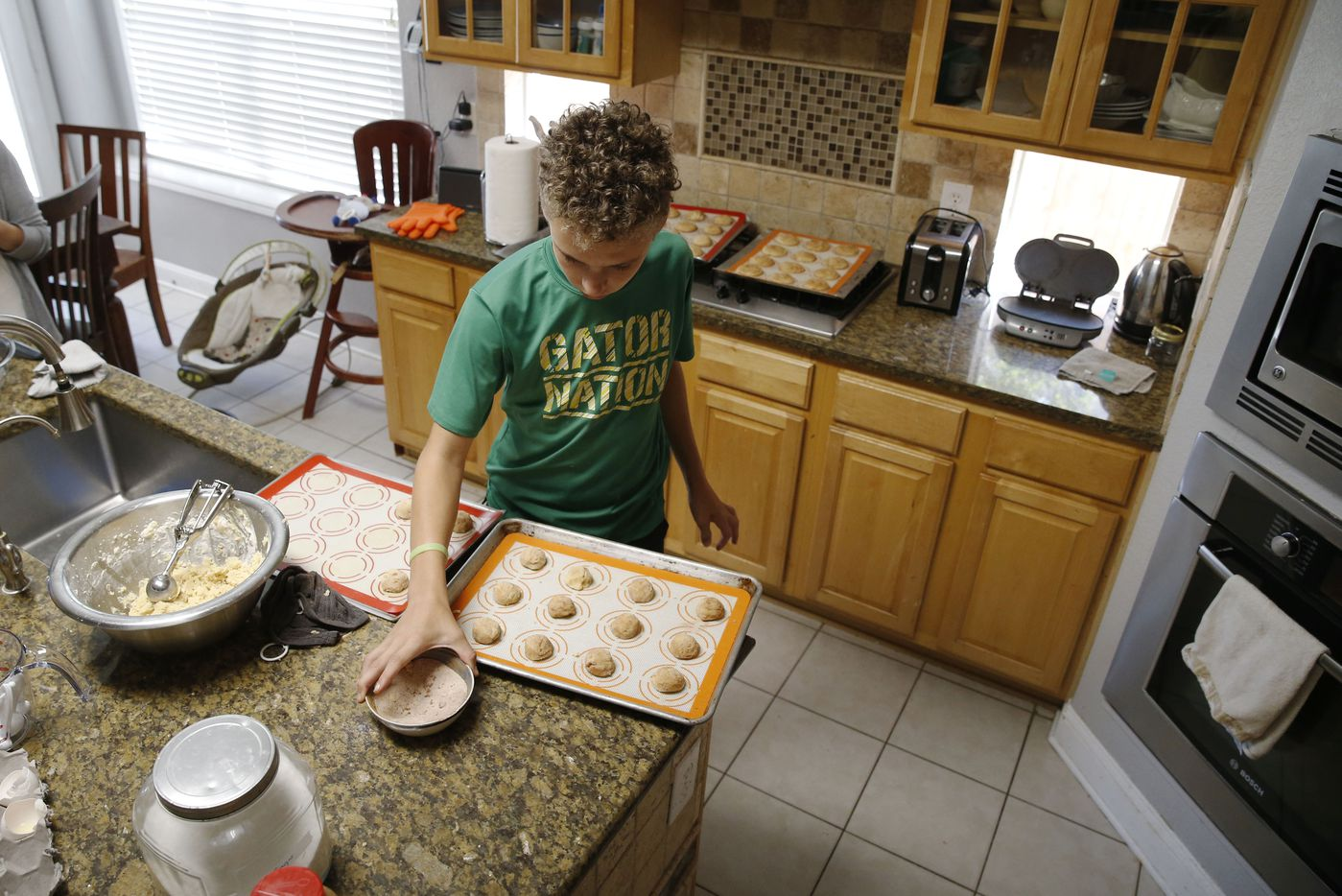 Brian Ellis works on making snickerdoodles at his home in Frisco on April 8, 2017. Brian started a cookie of the month club to help raise funds to train a diabetic alert dog.