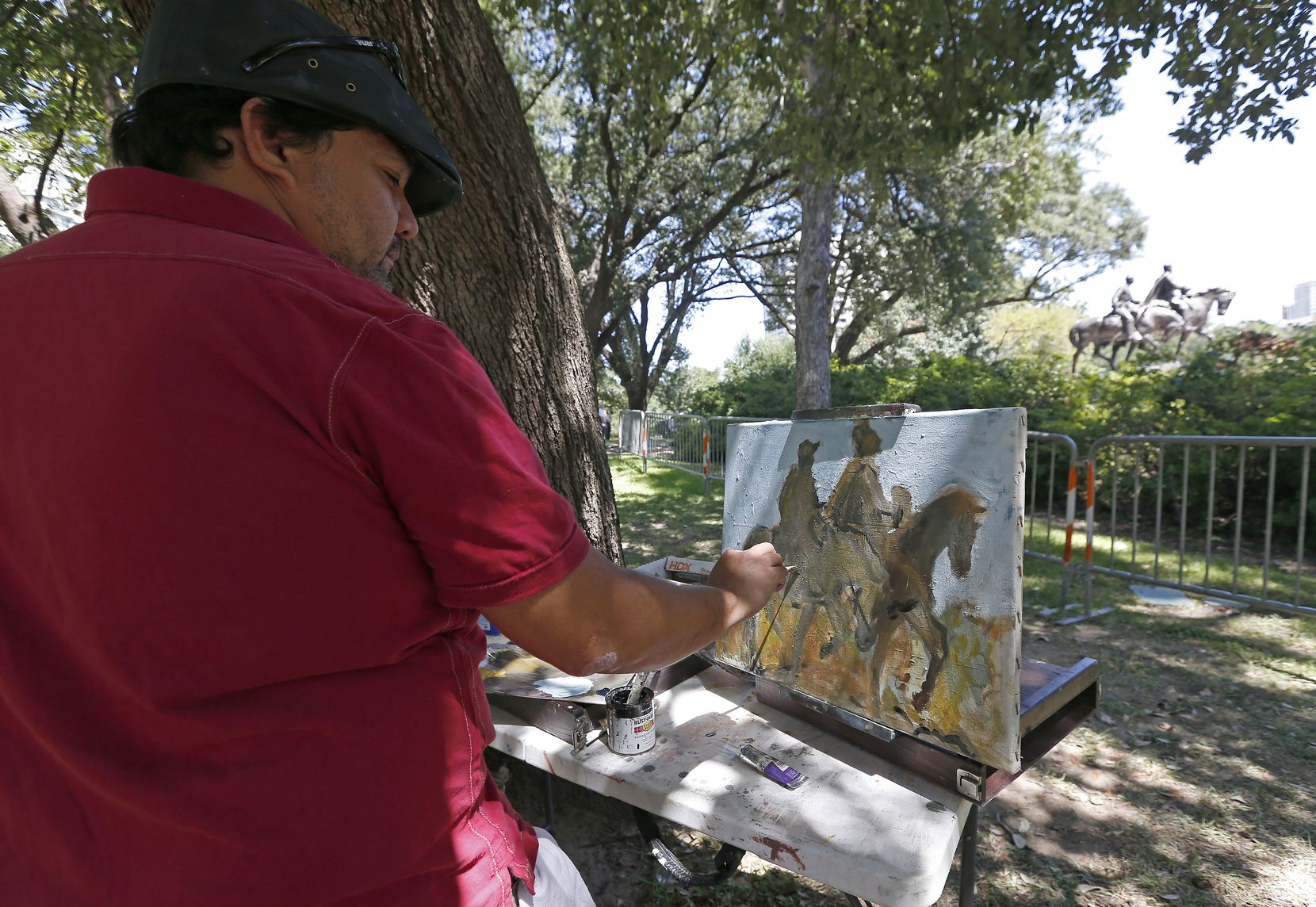 """Artist Jerrel Sustaita works on his painting of the Robert E. Lee statue at Robert E. Lee Park in Dallas, Thursday, Sept. 7, 2017. He said, """"I might not be able to do it tomorrow."""""""