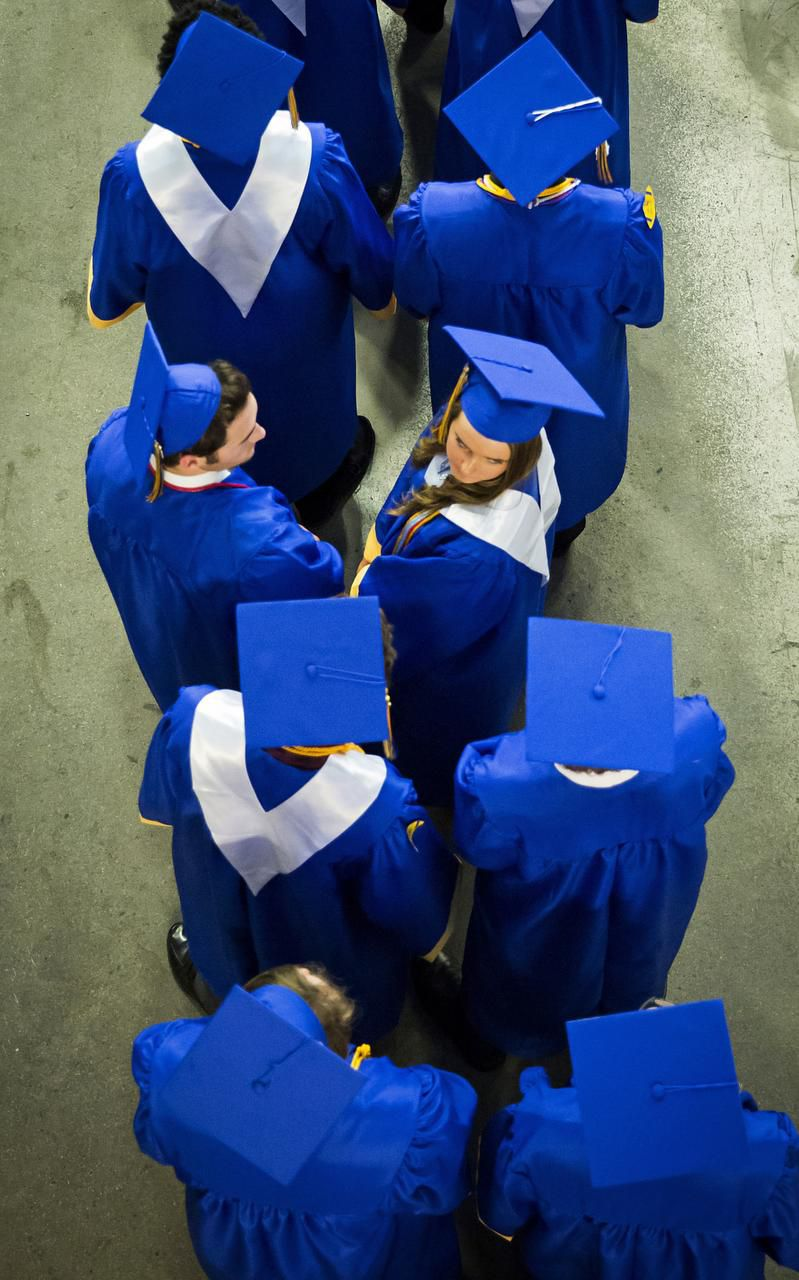 Graduating seniors lined up  to walk into the arena during the Frisco High School graduation ceremony.