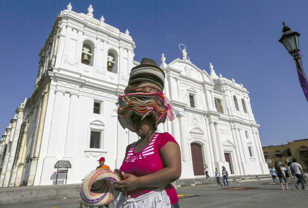 A vendor sells hats in front of the cathedral in Leon, Nicaragua, a good jumping-off point for volcano excursions.