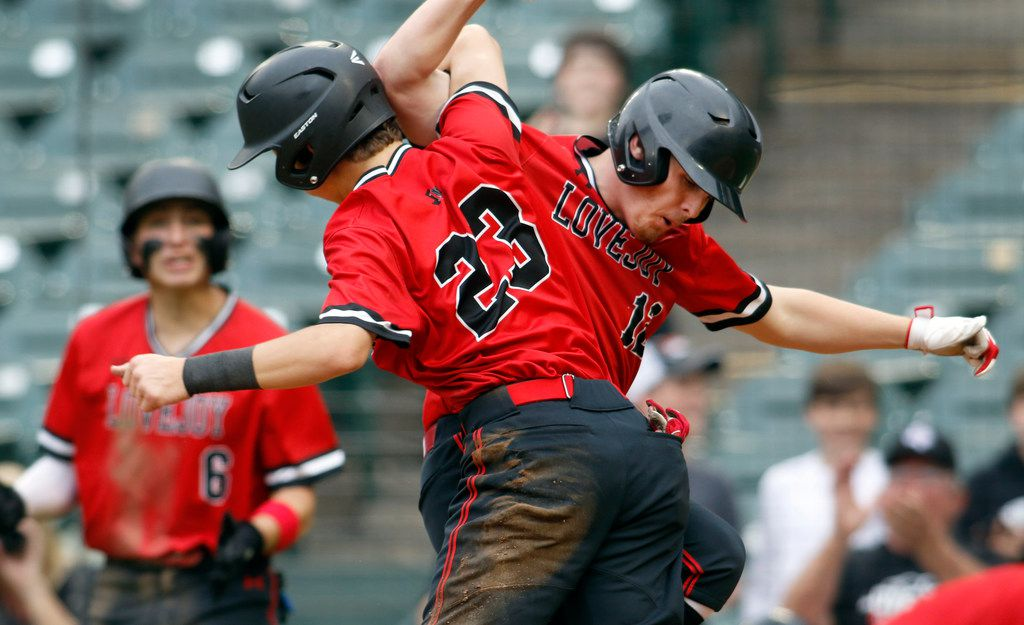 Lovejoy infielder Kolby Branch (23) gets tied-up in the moment as he celebrates with teammate Zach Smith (12) after Branch scored in the bottom of the 5th inning of play against Highland Park after reaching base on a double. Lovejoy prevailed 11-8 to capture Game 2 and sweep the series to advance. The two teams played Game 2 of a best-of-3 Class 5A area-round baseball playoff series held at Globe Life Park in Arlington on May 11, 2019.  (Steve Hamm/ Special Contributor)