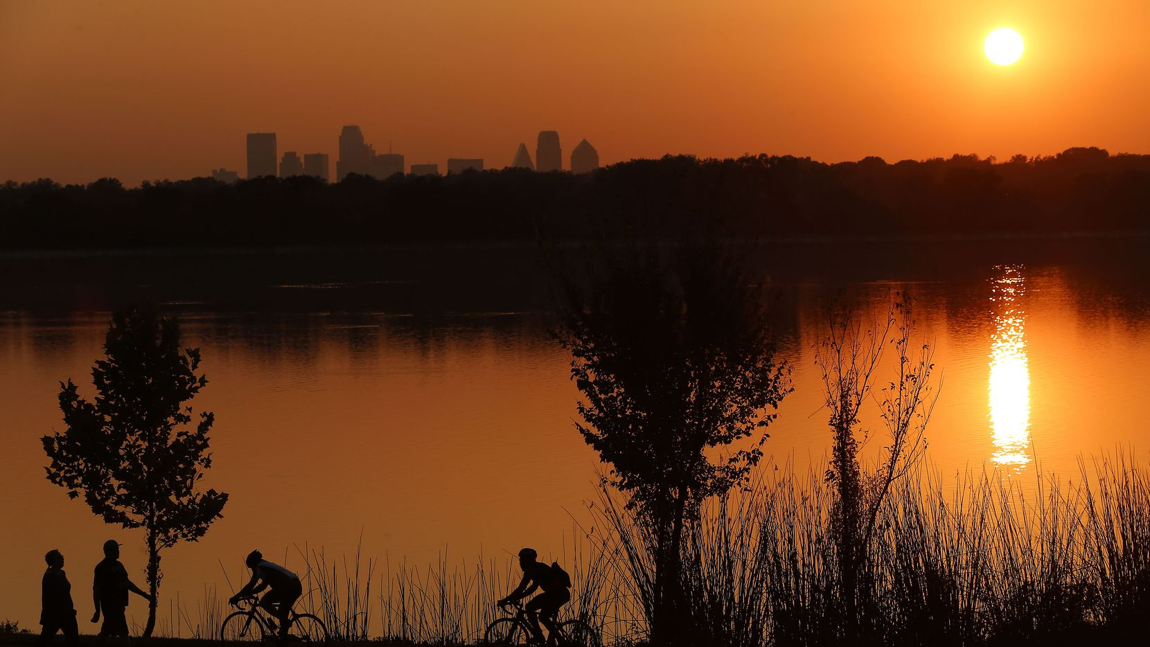 Cyclists ride on the path at White Rock Lake near the Test Pavilion at the Dallas Arboretum. (File Photo/Staff)