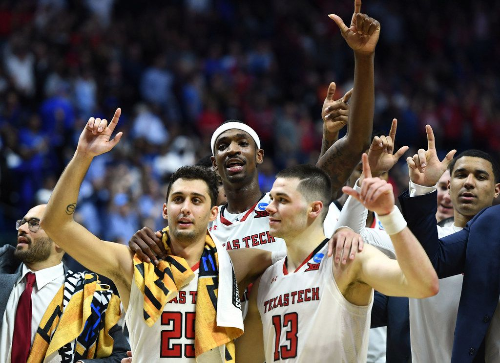 TULSA, OKLAHOMA - MARCH 24:  Davide Moretti #25, Tariq Owens #11, and Matt Mooney #13 of the Texas Tech Red Raiders celebrate their 78-58 victory over the Buffalo Bulls after their second round game of the 2019 NCAA Men's Basketball Tournament at BOK Center on March 24, 2019 in Tulsa, Oklahoma. (Photo by Stacy Revere/Getty Images)