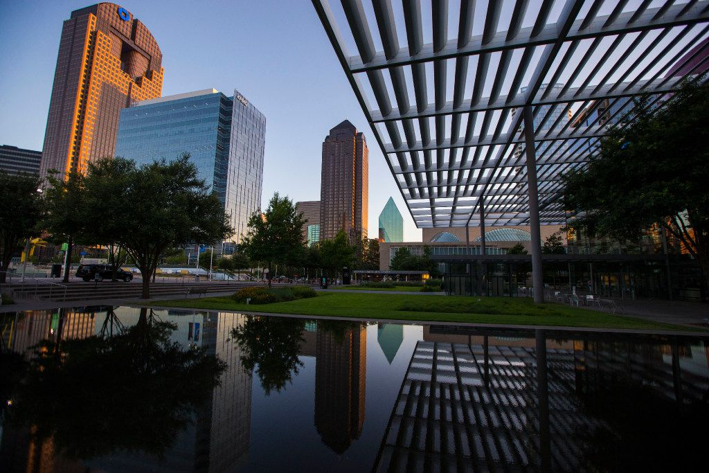 The Dallas skyline is mirrored in the Sammons Park reflecting pool at the Winspear Opera House on Wednesday, June 28, 2017.  (Ryan Michalesko/The Dallas Morning News)