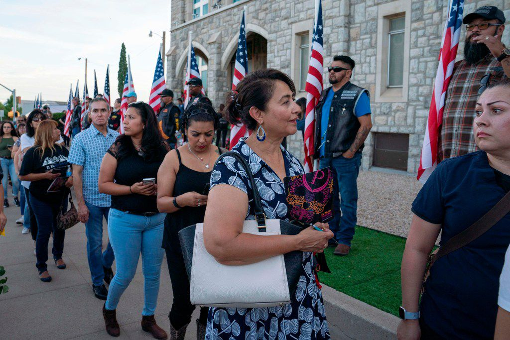 People wait in line to attend the visitation service for Margie Reckard at La Paz Faith Center in El Paso on August 16, 2019.