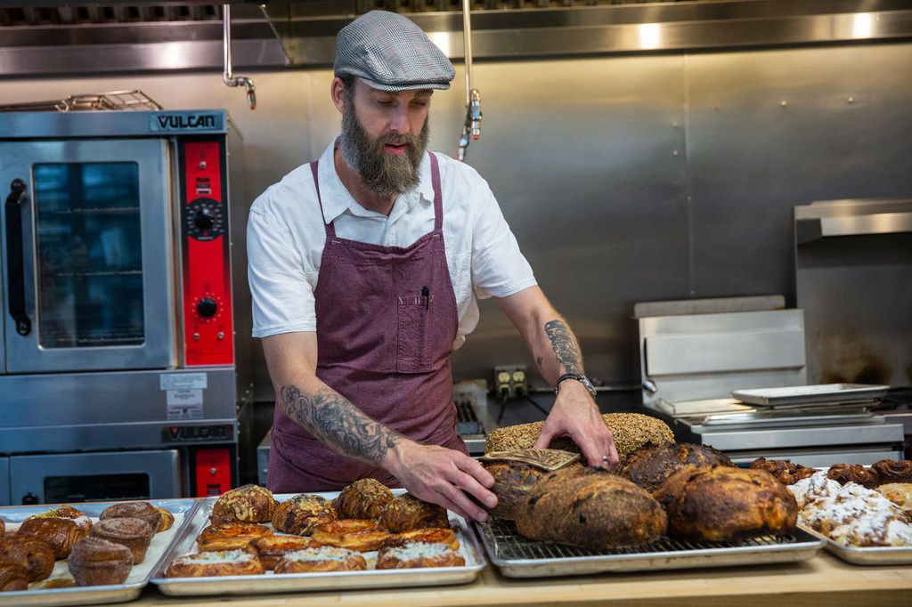 Matt Bresnan, head chef at Food Company, arranges baked goods in the Nonna kitchen in Highland Park in Dallas.