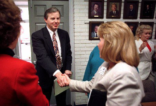 In this 1998 file photo, Rep. Joe Barton (center) visits with  members of a women's focus group at the Arlington  Chamber of Commerce.