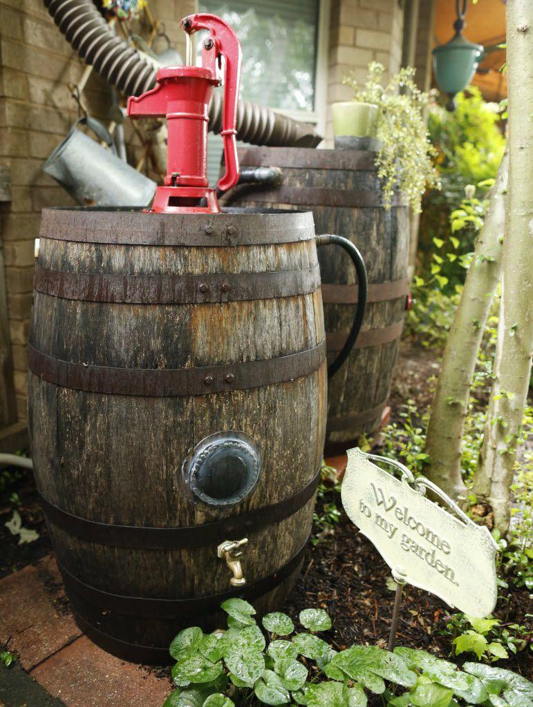 Rain barrels with a working pump in a Carrollton garden.